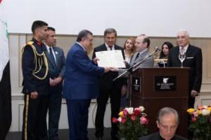 President Professor Dr. Anton Caragea decorates Iraq Ambassador
