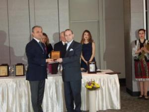 Professor A.Caragea receives the prize